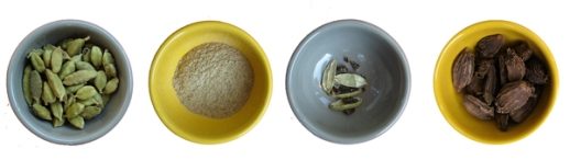 black cardamom and green cardamom as pods and also ground powder in bowls