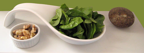baby spinach leaves and walnuts and a stone ingredients of spinach borani