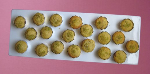 banana chocolate chip mini muffins in gold foil cups persianized with pistachio and cardamom