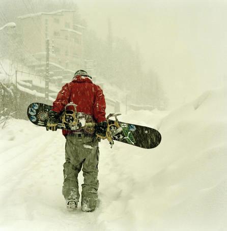Snowboarder, Shemshak, Alborz Mountains, Tehran  Snowboarder walking in heavy snowfall on way to skilift, Shemshak, Alborz Mountains.  Read more: http://www.lonelyplanet.com/iran/tehran/images/snowboarder-shemshak-alborz-mountains-tehran