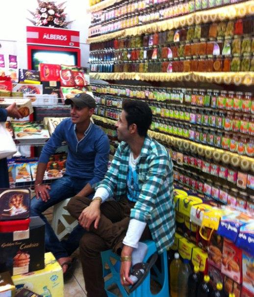 young Iranian men laughing store shomal  food blog Iranian cooking jam moraba