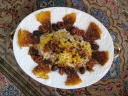Reshteh polo (Persian rice noodel) with tadig, garnished with plums, dates, raisins Persian food blog Iranian cooking recipes with photos