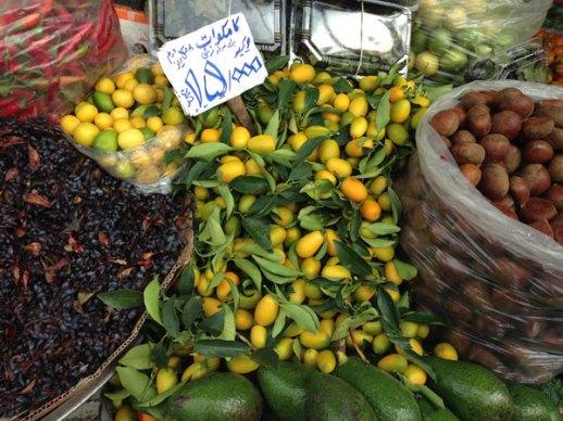 Sunny yellow kamquats in a market in Tehran, Iran