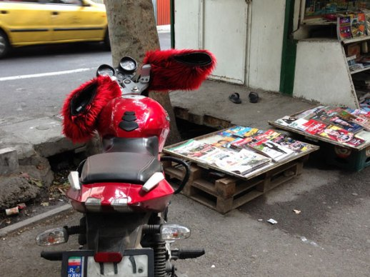 Motorcycle red fuzzy handle Tehran Iran | @FigandQuince (Persian food culture blog)