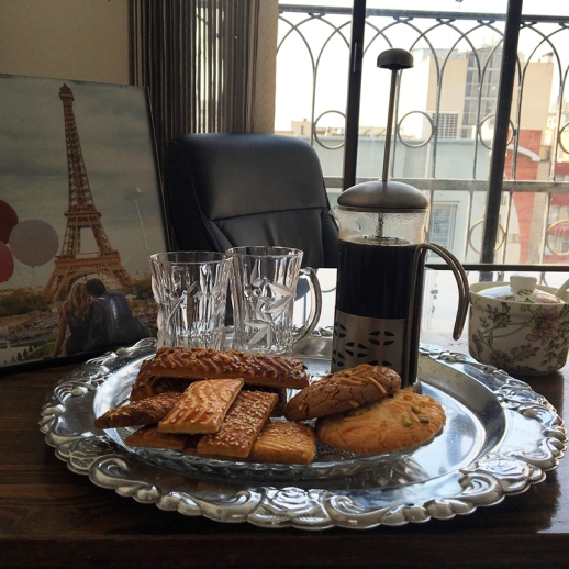 cookies french press coffee eiffel tower photo in an office in tehran Iran 2017