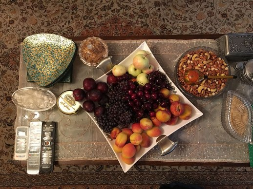 Coffee table with fruit, nuts, cookies in Tehran Iran