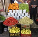 mulberry strawberry gojeh sabz apples and oranges in Persian fruit market in Tehran Iran 2016