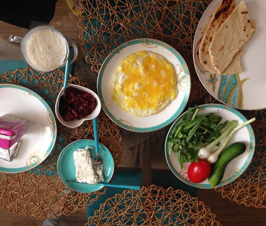 Persian breakfast: quail egg omelette; homemade strawberry jam; feta cheese; bread and banana milkshake | Persian food blog