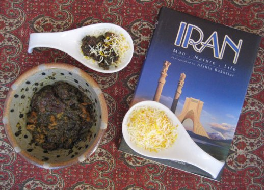 A bowl of Persian khoresh aloo esfenaj (spinach & prunes stew) and steamed rice Iranian food recipe by Fig & Quince (Iranian food blog)