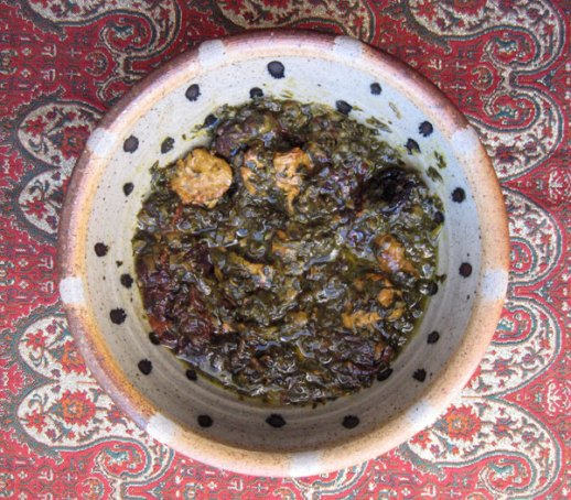 A bowl of Persian khoresh aloo esfenaj (spinach & prunes stew) Iranian food recipe by Fig & Quince (Iranian food blog)