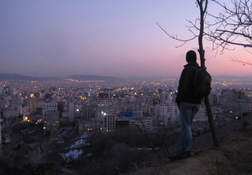 Someone watches the sun set.  Tehran | Iran  (Photo Credit:  Niall Doherty]