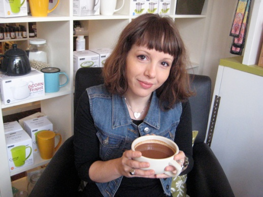 Jacqui holding a cup of her Cocoa Cardamom Cinnamon Drink | FigandQuince.com  (Persian food and