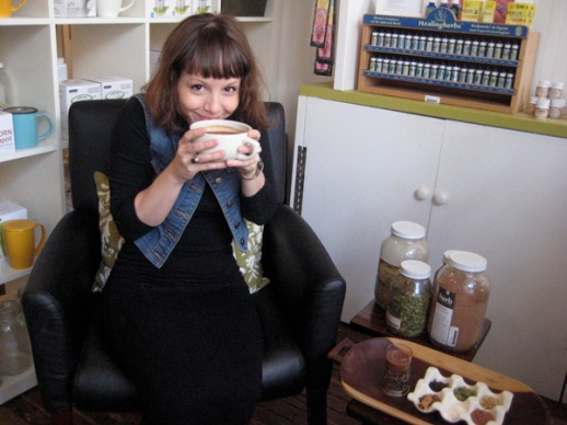 Jacqui holding a cup of her Cocoa Cardamom Drink