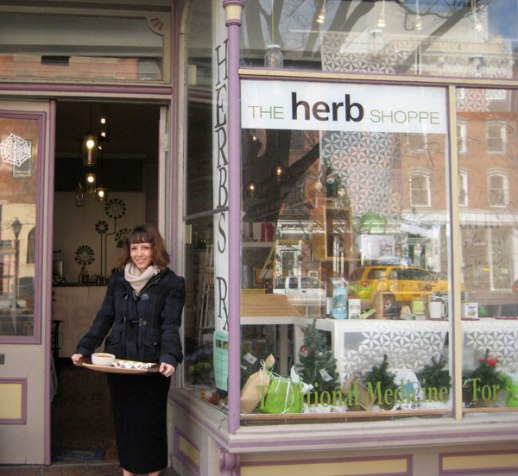 The Herb Shoppe Brooklyn Atlantic Avenue store front & young woman