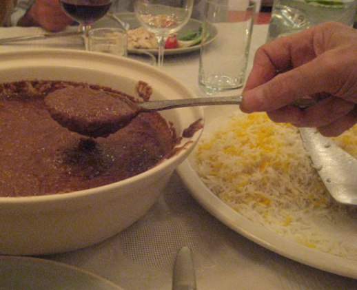 Fesenjoon or fessenjoon Persian stew of pomegranate and walnut a popular delicious Iranian food