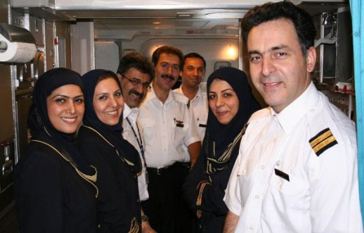 Iran Air Flight Attendants, pilot and crew posing inside the plane