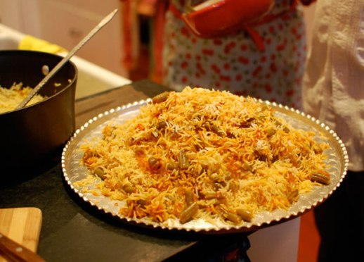 Silver tray with mound of Loobiya polo, Persian green bean mixed rice Iranian food recipe