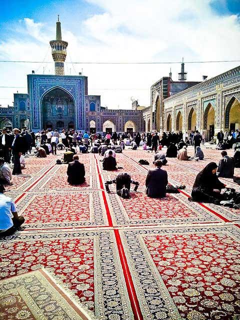 Pilgrims at the tomb of Emam Reza in Mashahd | Source