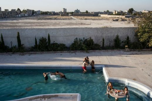 Socializing at a swimming pool in Tehran.