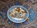 Meigoo polo (Persian shrimp rice) and beautiful Persian carpet