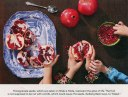 pretty aerial view of several hands seeding pomegranates