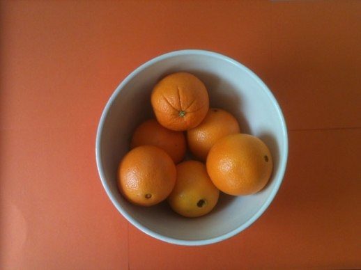 Oranges in a bowl on orange background | @FigandQuince (Persian food culture blog)