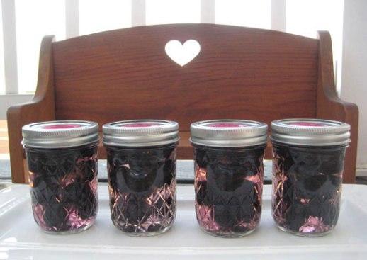 Grape pickle Persian torshi jars on wooden bench w/ heart shaped carving. Persian food blog recipe