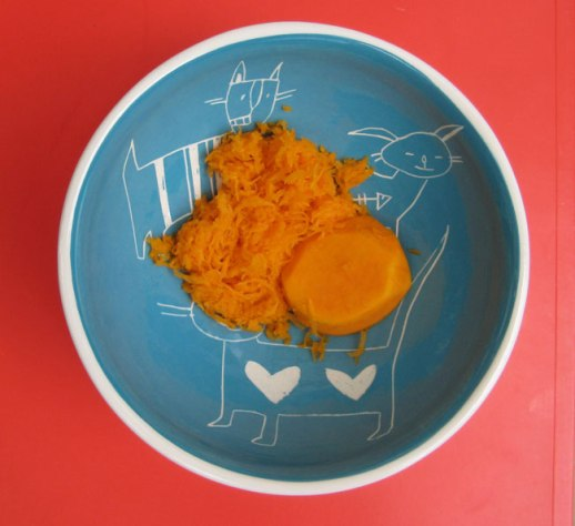 squash (kadoo halvaee) grated in blue bowl on orange background | @Figandquince (Persian food culture blog)