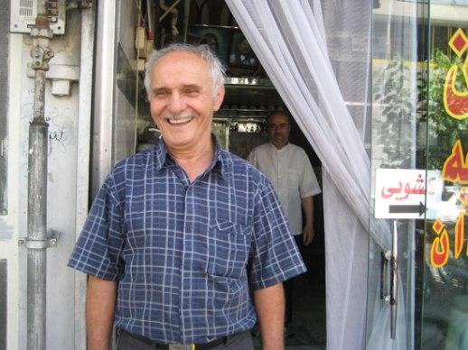 Iranian man old beaming Tehran Iran kaleh pacheh shopkeeper
