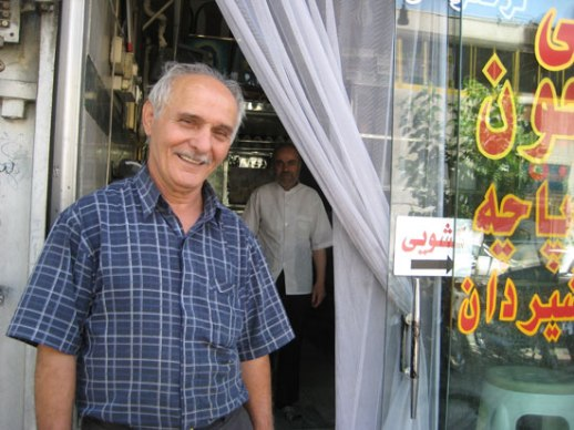 Iranian man old beaming Tehran Iran kaleh pacheh shopkeeper