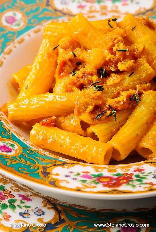 Tortiglioni Pancetta closeup of Pasta Pepper Italian food on beautiful floral pattern china