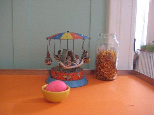 Merry go round toy, jar orange peels & pink egg still life orange background | @FigandQuince (Persian food culture blog)