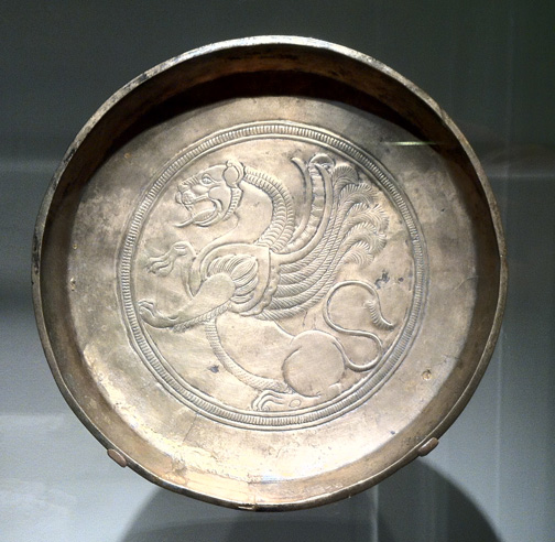 Ancient Persia plate with motif of winged lion (fantastic feline) on view at the perm exhibit of the Sackler Freer Gallery of the Smithsonian Musuems of the Asian Arts