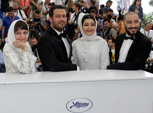 director Ida Panahandeh, actors Navid Mohammadzadeh, Sareh Bayat and Pejman Bazeghi pose for photographers during a photo call for the film Nahid, at the 68th international film festival, Cannes, southern France
