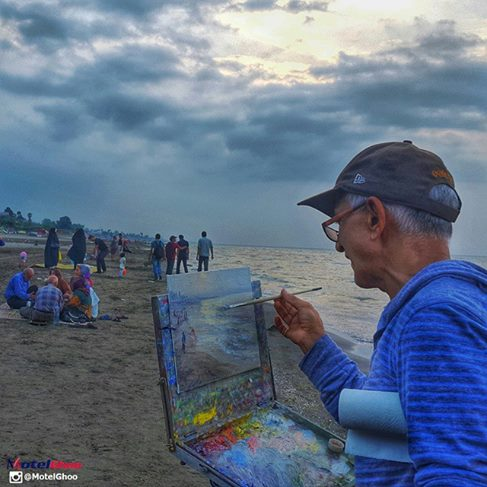 Artist painting at sunset on the Mazandaran beach of the Caspian sea region of Iran | FigandQuince.com