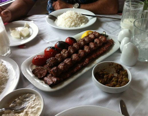 Plate of kabab & jojeh kabab served w Persian rice and doogh and mast musir at popular Iranian restaurant in Tehran, Iran | FigandQuince.com