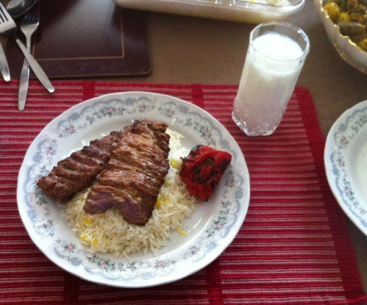 plate of cholo kabab (Persian rice and meat) with a glass of doogh (yogurt based Persian soft drink) at a restaurant in Tehran, Iran |FigandQuince.com