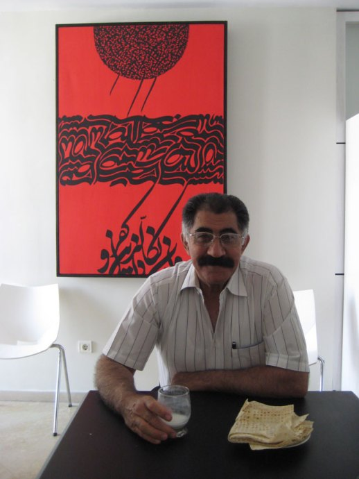 Mustachioed Persian Gentleman drinking doogh. Modern Calligraphy Art behind him. | FigandQuince.com Tehran, Iran