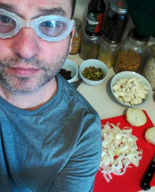 Dan with goggles chopping oinoins to keep tears away posted by Fig & Quince (Iranian food culture blog)