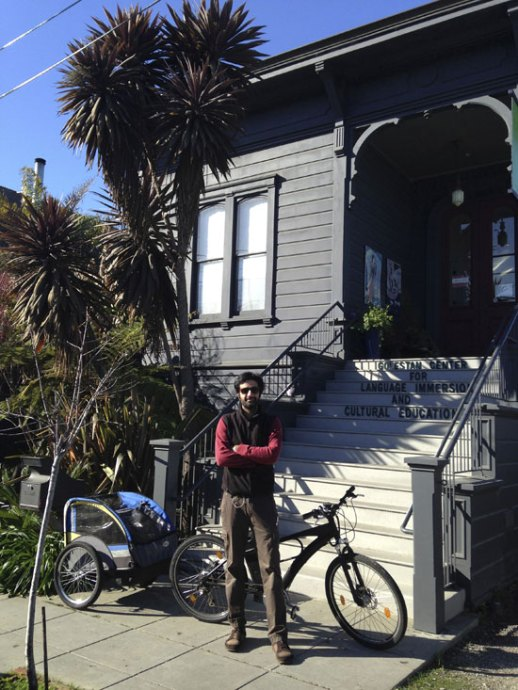 Man with bike posing in front of cottage in Berkeley CA posted by Fig & Quince (Persian food blog)