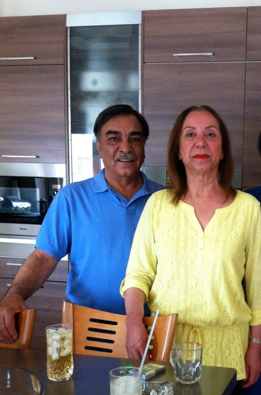 Iranian couple in their kitchen posing for a photograph, Tehran Iran 2014
