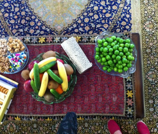 Persian table laden with fruit goodies assorted edibles to receive a guest (mehmooni) | Kermanshah, Iran may 2014