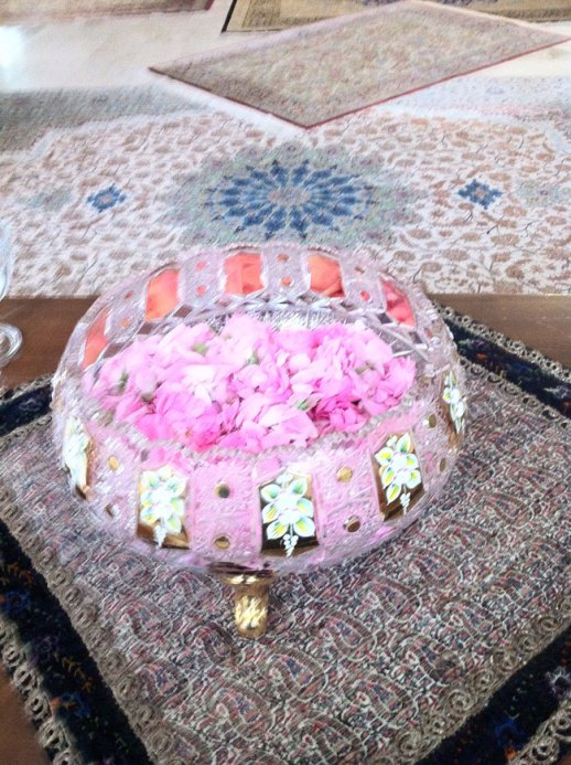 crystal bowl filled w pink Persian rose petals on termeh fabric with Persian carpets. Kermanshah, Iran | My Epic Trip to Iran 2014 @figandQuince