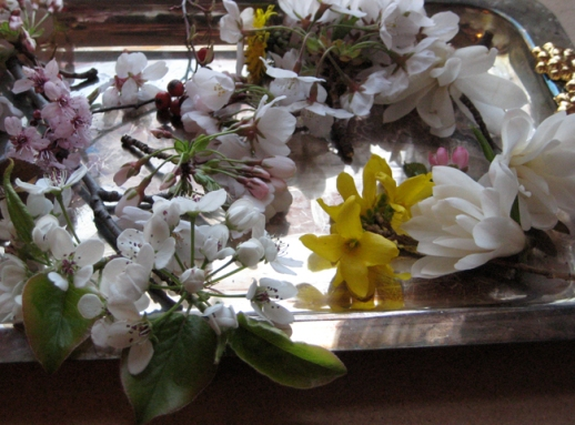 A tray filled with colorful and dainty spring blossoms