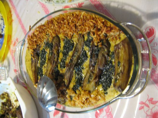 Persian eggplant dish called kashk e bademjoon made with eggplants, caramelized onions and kashk | Kermanshah, iran 2014
