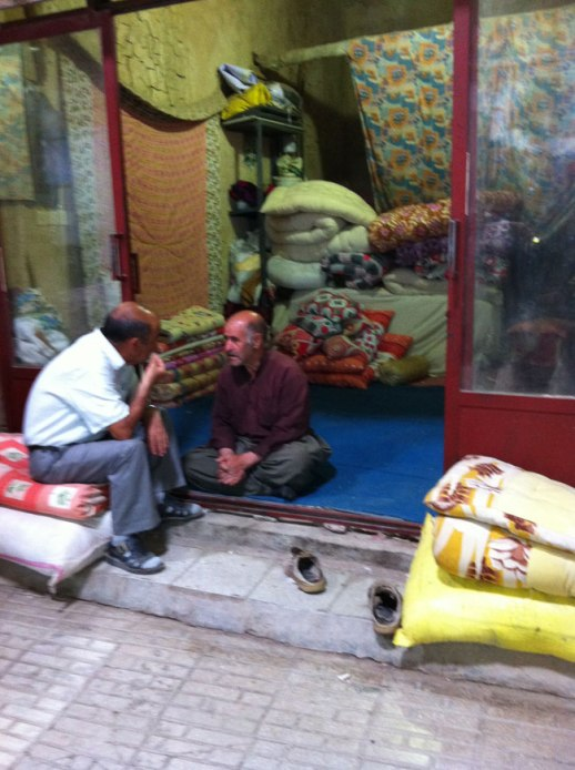 Persian merchants sitting down taking a break and chatting at Kermanshah Grand Bazaar, Iran | @FigandQuince (Persian food culture blog) My Epic trip to Iran 2014