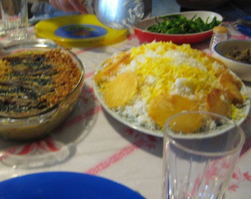 potato tadig (crunchy bottom of the pot Persian style) and polo (Persian rice) and persian eggplant dish \ Kermanshah, iran 2014