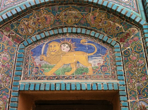 sun lion Persian emblem above wooden gate enrance of Takieh Moaven Malek in Kermanshah, Iran | @figandquince (Persian food culture blog)