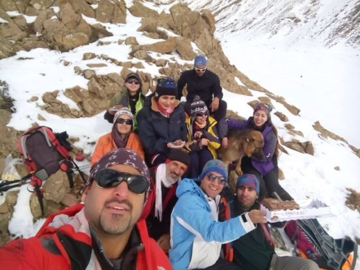 Group selfie of Iranian friends in snowy Lavasan Tehran Iran mountains