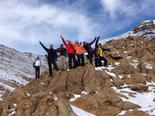 """Iranian men women friends posing on top of rock in the snowy """"carrot fields"""" of Lavasan Tehran Iran"""